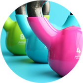 A set of three coloured kettlebells sitting one behind the other