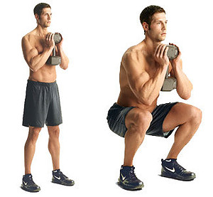 A man holding one dumbbell with both hands performing a squat