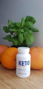 A-bottle-of-Keto-Actives-next-to-some-oranges