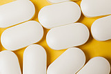 White-L-Carnitine-tablets-on-a-yellow-background