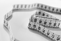 A-white-tape-measure-on-a-white-background