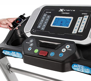 A-close-up-of-the-XTERRA-TRX2500 treadmill-display-console-with-MP3-device-attached