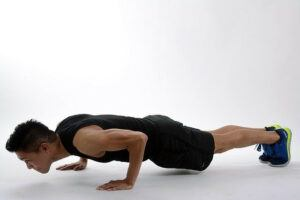 Guy performing the military press-up