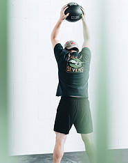 A-guy-working-out-with-a-medicine-ball