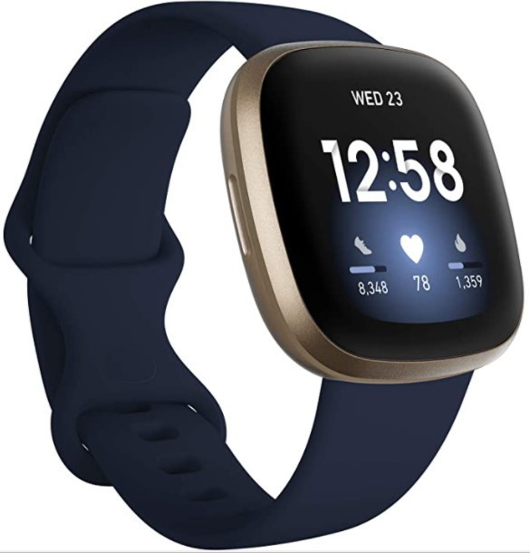 A close-up of the Fitbit Versa 3 with gold chassis and blue strap