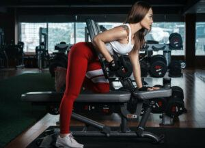 Woman-working-with-a-dumbbell-on-weight-bench