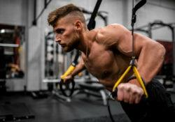 Man-performing-incline-chest-press-with-suspension-ropes